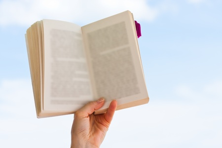 Hand holding book over blue sky Stock Photo - 13528866