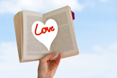 Love concept  Hand holding book with love wording Stock Photo - 13528870