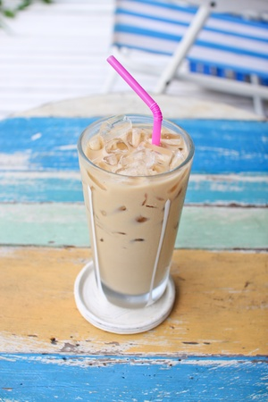 ice coffee on grunge wood table photo