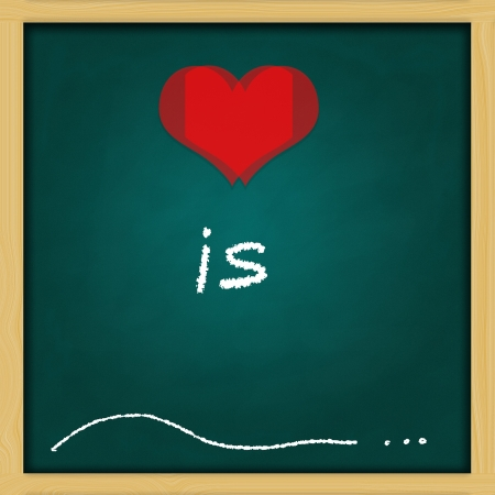 conceptual  love is, hand drawing on green chalkboard Stock Photo - 13964441