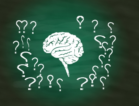 Brain thinking conceptual on green chalkboard