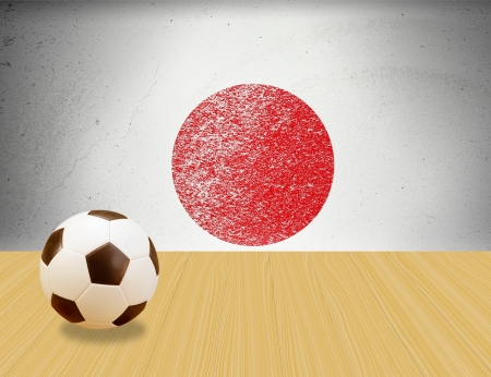 soccer ball on  wooden floor with grunge Japan flag background photo