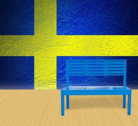 blue chair wooden floor with Sweden grunge flag background photo
