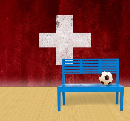 soccer ball and blue chair wooden floor with grunge flag background photo