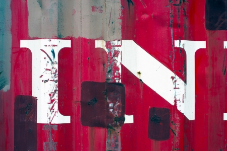 White paint splatters on a red steel wall background texture photo