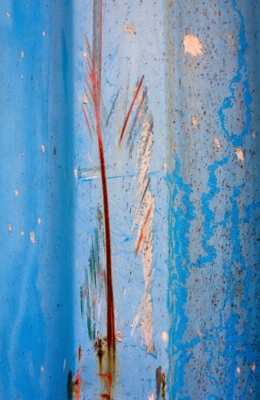 color paint splatters on blue grunge steel wall background texture photo