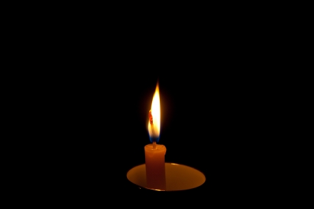 Burning candles in Porcelain cup in the dark photo