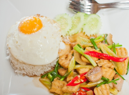 sunny-side up egg on rice with spicy fried vegetable and pork slice,Thai menu photo