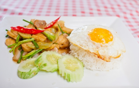 sunnyside: sunny-side up egg on rice with spicy fried vegetable and pork slice,Thai menu