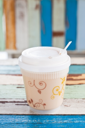 Hot coffee cup on retro stripe background photo