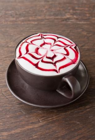 A coffee Latte art   on teak wood table Stock Photo - 14457814