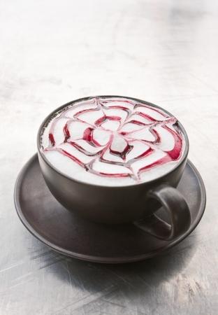 a coffee Latte art   on grunge white background photo