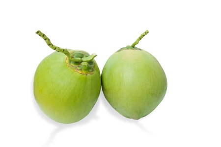 Green coconuts fruit isolated on white and shadow