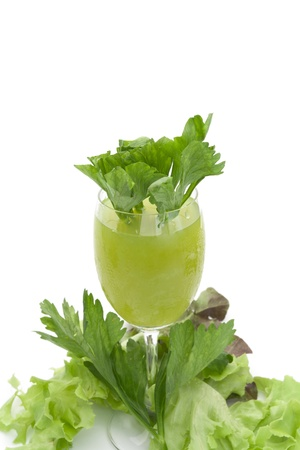 Pure fresh green vegetable juice in glass isolated on white background    healty concept photo