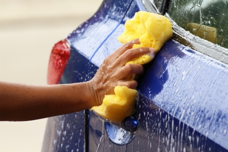 wash car: outdoor car wash with yellow spong Stock Photo