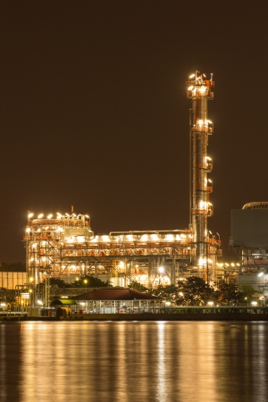 Oil refinery plant night scene nearby river in Thailand photo