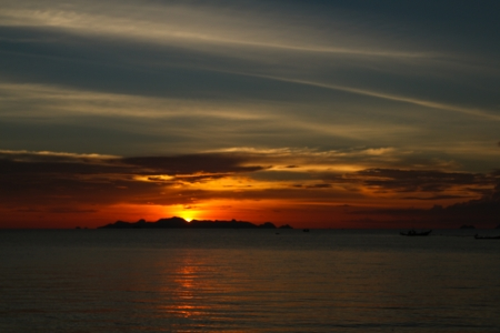 Tropical sunset over the island in Thailand photo