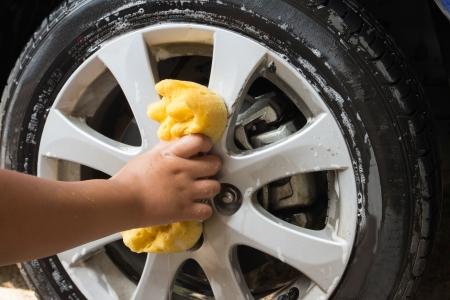 car polish: Outdoor tire car wash with yellow sponge