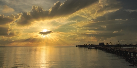 Golden ray sunset over Samui harbour,Thailand photo