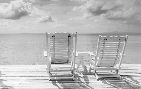 cozy white beach chair in paradise   balck and white concept photo