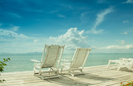 cozy white beach chair in paradise photo