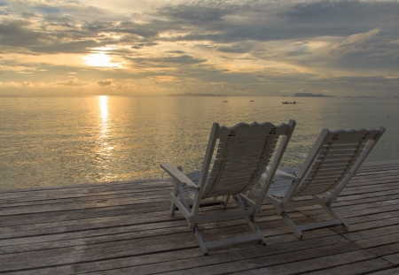 Cozy white chairs at resort in paradise Thailand at dusk photo
