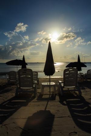 silhouette beach chairs and umbrellas on beautiful tropical sand beach,Thailand photo