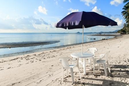 Beach chairs and umbrellas on beautiful tropical sand beach,Thailand photo