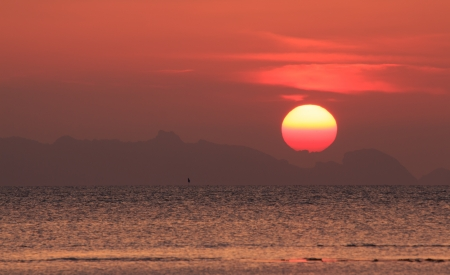 Dramatic Sunset over Mountain and Sea on Samui island,Thailand photo