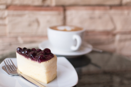 Hot coffee  and blueberry cheesecake  photo