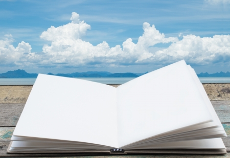 Open book with big cloud and sea background photo