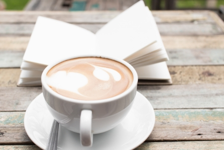 grune: Coffee cup and notebook on grune background