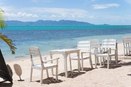 White table set beachside restaurant photo