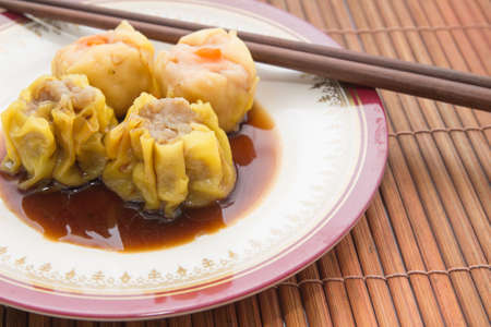 Dimsum set on brown bamboo background photo