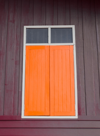 orange window on grunge wooden background photo