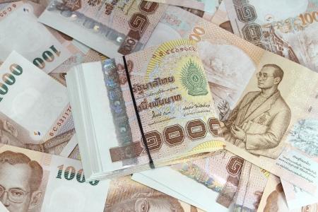 Thousand Thai baht banknotes background photo
