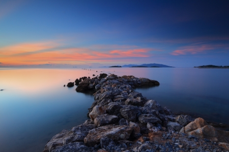 Long exposure seascape with fantastic rock surface at dusk,Samui island,Thailand photo