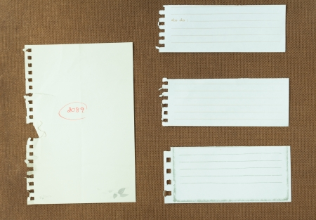 Grunge note papers over cork wood background photo