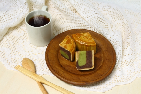 Coffe cup and moon cake serve on wooden dish photo