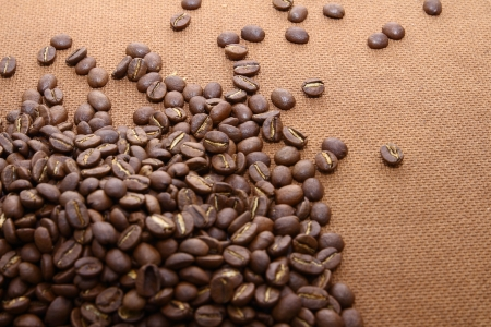 grung: Heaps of coffee beans on grung wooden board background