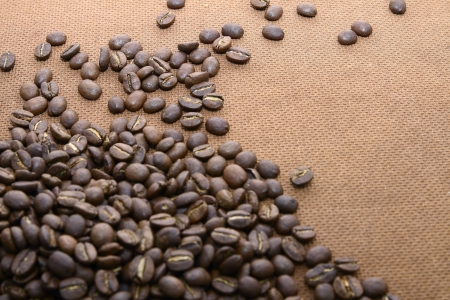 grung: Heaps of offee beans on grung wooden board background