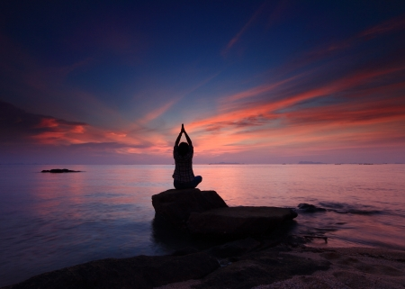 Silhouette yoga girl by the beach  sunset photo