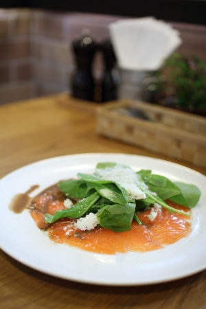 Fresh rocket green salad with salted salmon, selective focus  photo