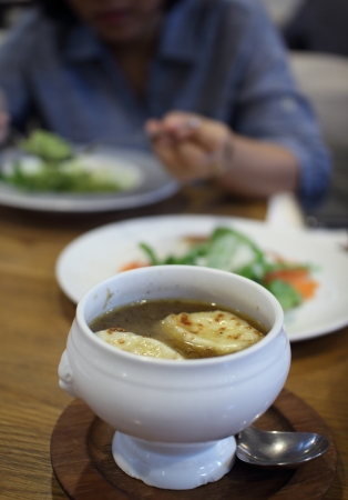 Onion soup starter meal in restaurant photo