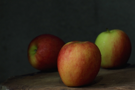 Still life with apples on wooden table photo