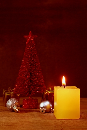 Christmas candle ornaments decoration on wooden background photo