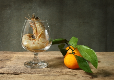 Still life with king prawn cocktail on wooden table and grunge background photo