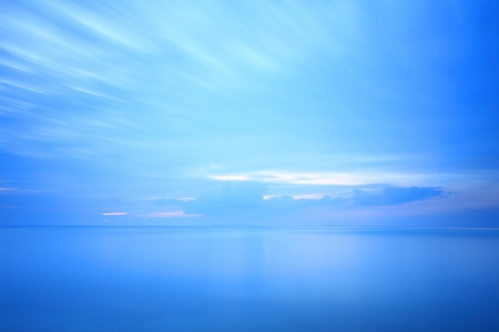 Long exposure seascape dramatic tropical sunset sky and sea at dusk  photo