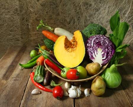 Still life harvested vegetables agricultural  on wooden background photo