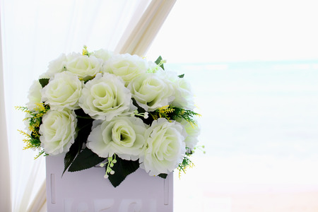 Artificial rose bouquet with sea background photo